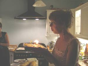 Sharon blows out the candles